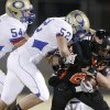 Ian Robinson of Douglass is brought down by Oologah\'s Garrett Martin, left, Kole Koenig, and Aaron Thompson during a high school football playoff game in Oklahoma City, Friday, Nov. 19, 2010. Photo by Bryan Terry, The Oklahoman