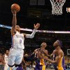 Oklahoma City\'s Russell Westbrook (0) takes the ball to the hoop over Los Angeles\' Kobe Bryant (24) and Dwight Howard (12) during an NBA basketball game between the Oklahoma City Thunder and the Los Angeles Lakers at Chesapeake Energy Arena in Oklahoma City, Friday, Dec. 7, 2012. Oklahoma City won, 114-108. Photo by Nate Billings, The Oklahoman