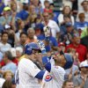 Chicago Cubs\' Luis Valbuena, right, celebrates his home run off St. Louis Cardinals relief pitcher Kevin Siegrist during the seventh inning of a baseball game Friday, July 25, 2014, in Chicago. (AP Photo/Charles Rex Arbogast)