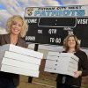 Putnam City West High School Patriots\' community supporters Kerrie Frazier and Kim Banz at the school\'s football field holding pizza boxes Wednesday. Oct. 27, 2010. For Friday Night Lights column. Photo by Paul B. Southerland, The Oklahoman