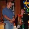 Harrah United Methodist pastor, right, the Rev. Glenda Skinner-Noble, presents OSU freshman Denison Helm with a gift during a special portion of the Aug. 13 service. To get him to classes on time, the United Methodist Youth members gave him a clock. Community Photo By: Lin Archer Submitted By: Lin, Harrah