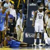 Oklahoma City\'s Reggie Jackson (15) is slow to get up next to Serge Ibaka (9) after falling to the court on a charge against Memphis\' Marc Gasol (33), right, next to Zach Randolph (50) in overtime of Game 4 of the second-round NBA basketball playoff series between the Oklahoma City Thunder and the Memphis Grizzlies at FedExForum in Memphis, Tenn., Monday, May 13, 2013. Memphis won 103-97 in overtime. Photo by Nate Billings, The Oklahoman