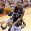 Photo - Memphis Grizzlies guard Mike Conley, top, goes to the basket over Los Angeles Clippers guard Chris Paul during the first half of Game 2 of a first-round NBA basketball playoff series, Monday, April 22, 2013, in Los Angeles.  (AP Photo/Mark J. Terrill)