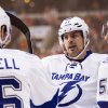Photo - Tampa Bay Lightning's Alex Killorn, center, celebrates his goal with Teddy Purcell, left, and Valtteri Filppula, right, of Finland, during the first period of an NHL hockey game against the Philadelphia Flyers, Saturday, Jan. 11, 2014, in Philadelphia. (AP Photo/Chris Szagola)