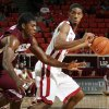OU\'s Cameron Clark (21) dribbles away from Mark Robertson (31) of Maryland Eastern Shore during the men\'s college basketball game between Maryland Eastern Shore and Oklahoma at Lloyd Noble Center in Norman, Okla., Monday, January 3, 2011. Photo by Nate Billings, The Oklahoman
