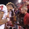 Oklahoma\'s Kenny Stills (4) signs autographs for fans during the college football game between the University of Oklahoma Sooners (OU) and the University of Kansas Jayhawks (KU) on Sunday, Oct. 16, 2011. in Lawrence, Kan. Photo by Chris Landsberger, The Oklahoman