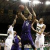 Northwestern forward Jared Swopshire (12) grabs a rebound against Baylor guard Brady Heslip (5) and Isaiah Austin (21) in the first half of an NCAA college basketball game, Tuesday, Dec. 4, 2012, in Waco, Texas. (AP Photo/Tony Gutierrez)