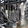 Charred beams and framing studs remain after a fatal house fire killed five, including four children, in Newnan, Ga., Saturday, April 27, 2013. The fire killed Alonna T. McCrary, 27, as well as her 5-year-old daughter Eriel McCrary and 2-year-old daughter Nikia White, according to Glenn Allen, the Georgia state Insurance commissioner\'s spokesman. Two other children, Messiah White, 3, and McKenzie Florence, 2, also died. Allen said the two were sleeping over at the home. A fifth child, 11-year-old Nautica McCrary, escaped the burning home and was taken to a hospital to be treated for smoke inhalation. (AP Photo/David Tulis)