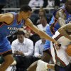 Photo - Oklahoma City Thunders' Thabo Sefolosha, left, knocks the ball away from Milwaukee Bucks' Monta Ellis, right, during the first half of an NBA basketball game Monday, April 9, 2012, in Milwaukee. (AP Photo/Jeffrey Phelps) ORG XMIT: WIJP104  JEFFREY PHELPS - AP