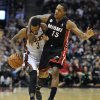 Milwaukee Bucks\' Brandon Jennings (3) is fouled by Miami Heat\'s Mario Chalmers (15) during the second half of an NBA basketball game on Saturday, Dec. 29, 2012, in Milwaukee. The Bucks defeated the Heat 104-85. (AP Photo/Jim Prisching)