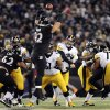Photo - Baltimore Ravens nose tackle Haloti Ngata (92) tries but cannot block a pass by Pittsburgh Steelers quarterback Ben Roethlisberger (7) in the first half of an NFL football game Thursday, Nov. 28, 2013, in Baltimore. (AP Photo/Gail Burton)