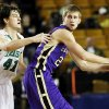 Chickasha\'s Joey Sylvester (24) keeps the ball away from Bishop McGuinness\' David Love (41) during a Class 5A boys high school basketball game in the semifinals of the state tournament at the Mabee Center in Tulsa, Okla., Friday, March 8, 2013. Bishop McGuinness beat Chickasha, 50-40. Photo by Nate Billings, The Oklahoman