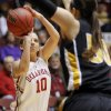 OU\'s Morgan Hook (10) shoots over Missouri\'s Christine Flores (10) during the Big 12 tournament women\'s college basketball game between the University of Oklahoma Sooners and the University of Missouri Tigers at Municipal Auditorium in Kansas City, Mo., Thursday, March 8, 2012. Photo by Nate Billings, The Oklahoman