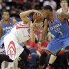 Houston Rockets\' Jeremy Lin tries to control ball away from Oklahoma City Thunder defender Perry Jones during the second quarter of an NBA preseason basketball game in Hidalgo, Texas, Wednesday, Oct. 10, 2012. (AP Photo/Delcia Lopez)