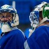 Vancouver Canucks\' goalies Roberto Luongo, left, and Cory Schneider talk during an informal hockey practice at the University of British Columbia in Vancouver, British Columbia on Friday Jan. 11, 2013. (AP Photo/The Canadian Press, Darry; Dyck)