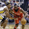 Houston Rockets\' James Harden (13) goes to the basket against Indiana Pacers\' Orlando Johnson during the first half of an NBA basketball game Friday, Jan. 18, 2013, in Indianapolis. (AP Photo/Darron Cummings)