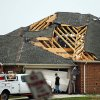 A man walks in front of a home damaged by Wednesday\'s tornado in Cleburne, Texas on Thursday, May 16, 2013. Ten tornadoes touched down in several small communities in Texas overnight, leaving at least six people dead, dozens injured and hundreds homeless. Emergency responders were still searching for missing people Thursday afternoon. (AP Photo/Ron Russek II)