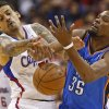 Oklahoma City\'s Kevin Durant (35) has the ball knocked away by Los Angeles\' Matt Barnes (22) during Game 4 of the Western Conference semifinals in the NBA playoffs between the Oklahoma City Thunder and the Los Angeles Clippers at the Staples Center in Los Angeles, Sunday, May 11, 2014. Photo by Nate Billings, The Oklahoman