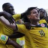 Photo - Colombia's James Rodriguez (10) celebrates with his teammates after scoring his side's third goal during the group C World Cup soccer match between Colombia and Greece at the Mineirao Stadium in Belo Horizonte, Brazil, Saturday, June 14, 2014. Colombia defeated Greece 3-0. (AP Photo/Fernando Vergara)