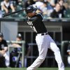 Photo - Chicago White Sox's Alex Rios watches his grand slam home run during the third inning of an interleague baseball game against the Atlanta Braves, Saturday, July 20, 2013, in Chicago. (AP Photo/Paul Beaty)