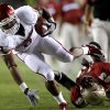 Oklahoma\'s Dominique Whaley (8) runs past Florida\'s Bert Reed (83) during a college football game between the University of Oklahoma (OU) and Florida State (FSU) at Doak Campbell Stadium in Tallahassee, Fla., Saturday, Sept. 17, 2011. Photo by Bryan Terry, The Oklahoman