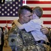 Michael Manning hugs his son Leaun as he is welcomed home during the return ceremony for the National Guard\'s 45th Infantry Brigade Combat Team troops at the National Guard Base on Thursday, March 15, 2012, in Oklahoma City, Oklahoma. Photo by Chris Landsberger, The Oklahoman