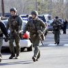 State Police are on scene following a shooting at the Sandy Hook Elementary School in Newtown, Conn., about 60 miles (96 kilometers) northeast of New York City, Friday, Dec. 14, 2012. An official with knowledge of Friday\'s shooting said 27 people were dead, including 18 children. (AP Photo/Jessica Hill)