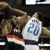 Portland Trail Blazers forward LaMarcus Aldridge, left, grabs an offensive rebound in front of Dallas Mavericks\' Devin Harris (20) during the first half of an NBA basketball game, Saturday, Jan. 18, 2014, in Dallas. (AP Photo/Tony Gutierrez)