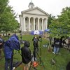 Photo -   Reporters work on the front lawn of the Centre County Courthouse in Bellefonte, Pa., Monday, June 4, 2012, a day before the start of the child sexual abuse trial of former Penn State college football assistant coach Jerry Sandusky. Jury selection is scheduled to begin Tuesday. (AP Photo/Gene J. Puskar)