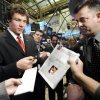 Sam Bradford, the 2008 Heisman Trophy winner from the University of Oklahoma (OU), signs autographs as he visits the New York Stock Exchange trading floor after he rang the opening bell Tuesday, Dec. 16, 2008. (AP Photo)