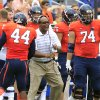 Photo - Virginia head coach Mike London, center, reacts to a play with linebacker Henry Coley (44) and guard Conner Davis (74) during the first half of an NCAA college football game against UCLA at Scott Stadium, Saturday, Aug. 30, 2014, in Charlottesville, Va. (AP Photo/Andrew Shurtleff)