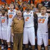 Oil tycoon and Oklahoma State suppoerter T. Boone Pickens, center, celebrates with Oklahoma State\'s basketball team members Marcus Smart (33), Mason Cox (30), Le\'Bryan Nash (2) and Alex Budke, right, following the team\'s 78-65 win over Texas in an NCAA college basketball game in Stillwater, Okla., Saturday, March 2, 2013. (AP Photo/Brody Schmidt)