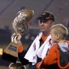 Photo - OKLAHOMA STATE UNIVERSITY / OSU / COLLEGE FOOTBALL / INSIGHT BOWL: Oklahoma State coach Mike Gundy holds the Insight Bowl trophy after defeating Indiana 49-33 in the college football bowl game Monday, Dec. 31, 2007, in Tempe, Ariz. (AP Photo/Paul Connors) ORG XMIT: PNS116