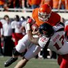 Oklahoma State\'s J.W. Walsh (4) is tackled by Texas Tech\'s D.J. Johnson (12) during a college football game between Oklahoma State University and the Texas Tech University (TTU) at Boone Pickens Stadium in Stillwater, Okla., Saturday, Nov. 17, 2012. Photo by Sarah Phipps, The Oklahoman