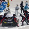 Photo - The pit crew of Ryan Truex works on his car during the NASCAR Sprint Cup Series auto race Sunday, March 2, 2014, in Avondale, Ariz. (AP Photo/Ross D. Franklin)