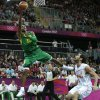 Brazil\'s Leandrinho Barbosa put up a shot after driving past Spain\'s Jose Calderon during a men\'s basketball game at the 2012 Summer Olympics, Monday, Aug. 6, 2012, in London. (AP Photo/Charles Krupa)
