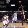 Los Angeles\' Kobe Bryant (24) shoots the ball beside Oklahoma City\'s Kevin Durant (35), Serge Ibaka (9), and Thabo Sefolosha (2) during Game 5 in the second round of the NBA playoffs between the Oklahoma City Thunder and the L.A. Lakers at Chesapeake Energy Arena in Oklahoma City, Monday, May 21, 2012. Photo by Bryan Terry, The Oklahoman