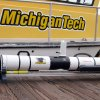 Photo - This undated photo proved by Michigan Technological University  shows an Iver 3 Autonomous Underwater Vehicle purchased by Enbridge Energy Partners for Michigan Technological University in Houghton, Mich. Michigan Tech's Great Lakes Research Center will use the device to conduct sonar inspections of Enbridge oil pipelines beneath the Straits of Mackinac. Some consider the pipes, laid in 1953, a symbol of the dangers lurking in the nation's sprawling web of buried oil and natural gas pipelines. (AP Photo/Michigan Technological University, Guy Meadows)