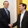 Greek leader of Coalition of the Radical Left party, SYRIZA, Alexis Tsipras, right, and leader of the Conservative Party of \'New Democracy\' Antonis Samaras smile as they shake hands before their meeting at the Greek Parliament in Athens, Wednesday, May 9, 2012. Greece\'s commitment to austerity is no longer valid because voters have rejected those deals, a left-wing party leader declared Tuesday as he tried to form a new coalition government. (AP Photo/Evi Fylaktou)