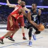 Eastern Conference\'s Dwyane Wade (3), of the Miami Heat, looks to pass as Western Conference\'s Kobe Bryant (24), of the Los Angeles Lakers, defends during the second half of the NBA All-Star basketball game, Sunday, Feb. 26, 2012, in Orlando, Fla. (AP Photo/Chris O\'Meara) ORG XMIT: DOA142