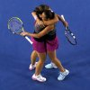 Photo - Italy's Sara Errani, left, and Roberta Vinci celebrate after defeating Russia's Ekaterina Makarova and Elena Vesnina in their women's doubles final at the Australian Open tennis championship in Melbourne, Australia, Friday, Jan. 24, 2014.(AP Photo/Eugene Hoshiko)