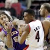 Portland Trail Blazers guard Nolan Smith (4) is double-teamed by Phoenix Suns\' Michael Beasley, left, and Kendall Marshall during the first half of an NBA basketball game in Portland, Ore., Tuesday, Feb. 19, 2013. (AP Photo/Don Ryan)