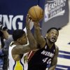 Indiana Pacers\' Paul George (24) makes a pass against Miami Heat\'s Udonis Haslem during the first half of Game 3 of the NBA Eastern Conference basketball finals in Indianapolis, Sunday, May 26, 2013. (AP Photo/Michael Conroy)
