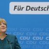 German Chancellor and chairwoman of the Christian Democratic party, CDU, Angela Merkel, smiles as she arrives for a news conference after a party\'s board meeting in Berlin, Monday, Sept. 23, 2013. German Chancellor Angela Merkel may have won an impressive third general election but she faces a delicate and lengthy task in forming a new government as party leaders met Monday to map out their next steps. Merkel\'s Union bloc achieved its best result in 23 years Sunday to put her on course for a third term, winning 41.5 percent of the vote and finishing only five seats short of an absolute majority in the lower house. However, Merkel\'s pro-business coalition partner since 2009 crashed out of Parliament. Words read: For Germany. (AP Photo/Matthias Schrader)
