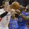 Oklahoma City\'s Reggie Jackson (15) fights for the ball with Houston\'s Omer Asik (3) during Game 6 in the first round of the NBA playoffs between the Oklahoma City Thunder and the Houston Rockets at the Toyota Center in Houston, Texas, Friday, May 3, 2013. Oklahoma City won 103-94. Photo by Bryan Terry, The Oklahoman