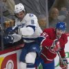 Photo - Montreal Canadiens' Max Pacioretty,right, checks Tampa Bay Lightning Mark Barberio during the first period of an NHL game in Montreal, Saturday, Feb. 1, 2014. (AP Photo/The Canadian Press, Peter McCabe)