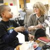 "Photo -      Fifth-grader Jaedon DeJear discusses the book ""The Watsons Go to Birmingham"" with Helen Sullivan, from the Reading Club. Photos by David McDaniel, The Oklahoman   David McDaniel -"