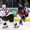 New York Rangers\' Ryan Callahan, right, shoots past New Jersey Devils\' Anton Volchenkov during the second period of an NHL hockey game on Sunday, April 21, 2013, in New York. (AP Photo/Seth Wenig)