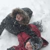 Joey Zimmerman, 7, and Abigail Zimmerman, 10, play out in the snow in Edmond Thursday morning. Submitted by Mark Zimmerman.
