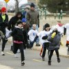Children and their parents start the fun run before the beginning of the